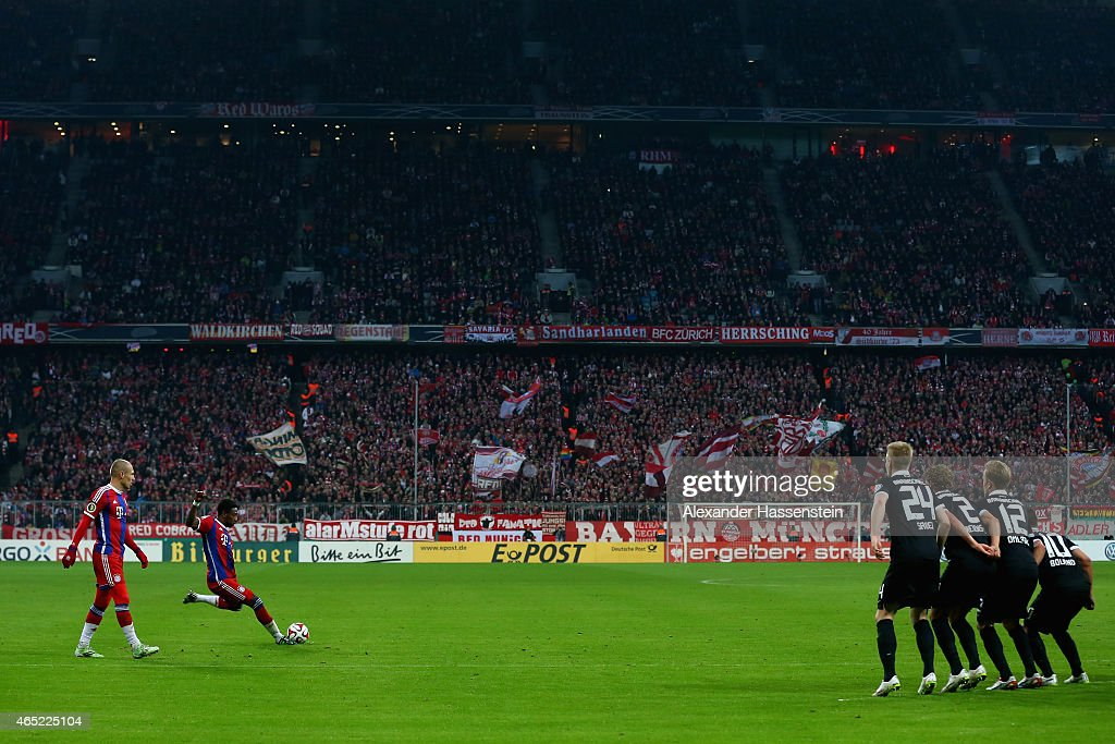 David Alaba of FC Bayern Muenchen scores the opening goal as he takes a free kick during the round of 16 DFB Cup match between FC Bayern Muenchen and...