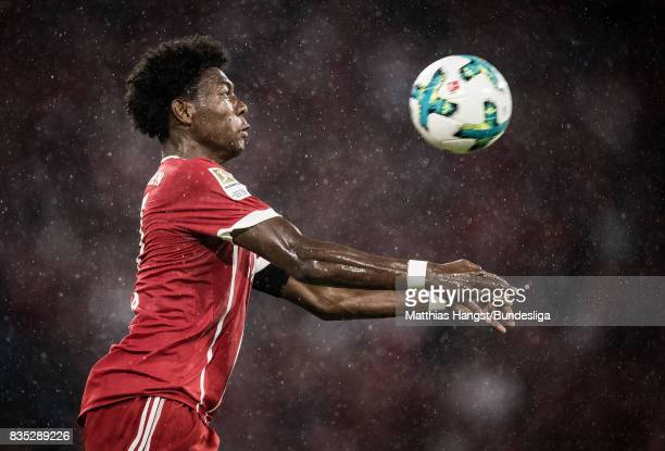 David Alaba of FC Bayern Muenchen stops the ball during the Bundesliga match between FC Bayern Muenchen and Bayer 04 Leverkusen at Allianz Arena on...