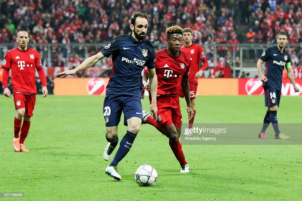 David Alaba of FC Bayern Munich and Juanfran Atletico Madrid of Madrid vie for the ball during the Champions League semifinal second leg soccer match between FC Bayern Munich and Atletico Madrid at the Allianz Arena on Mai 3, 2016, in Munich, Germany.