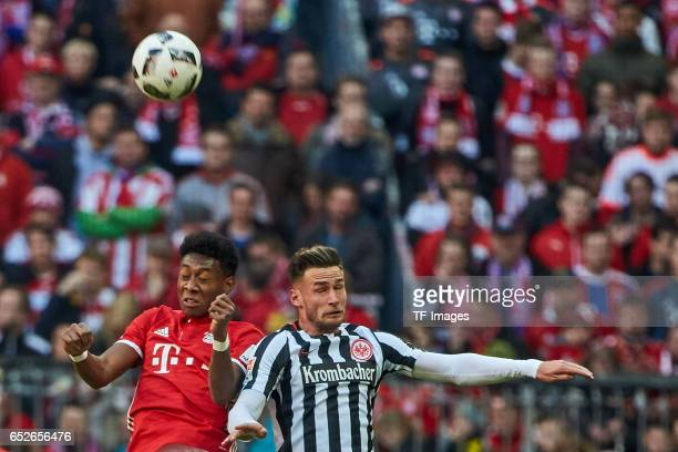 David Alaba of Muenchen and Danny Blum of Frankfurt battle for the ball during the Bundesliga match between Bayern Muenchen and Eintracht Frankfurt...