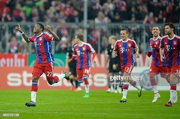 David Alaba of Muenchen and his teammates celebrate the opening goal during the DFB Cup round of sixteen match between FC Bayern Muenchen and...