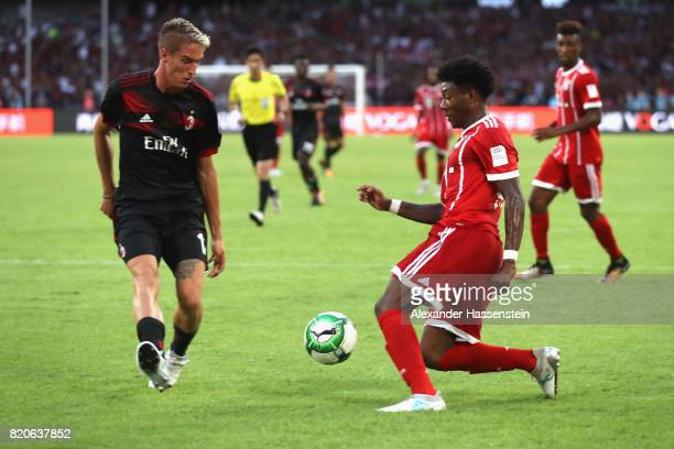 David Alaba of Muenchen battles for the ball with Andrea Conti of Milan during the International Champions Cup Shenzen 2017 match between Bayern...