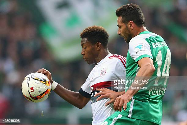 David Alaba of Muenchen battles for the ball with Claudio Pizarro of Bremen during the Bundesliga match between SV Werder Bremen and FC Bayern...