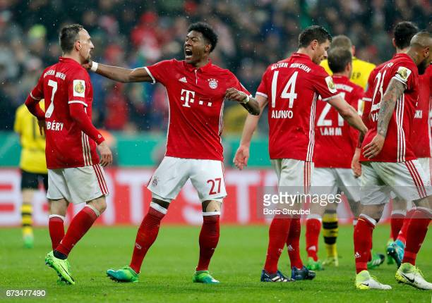 David Alaba of Muenchen celebrate with team mate Franck Ribery after he scores the 2nd goal during the DFB Cup semi final match between FC Bayern...
