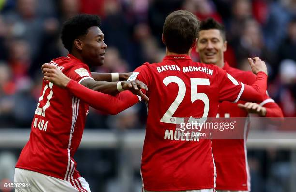 David Alaba of Muenchen celebrate with team mate Thomas Mueller after he scores the fourth goal during the Bundesliga match between Bayern Muenchen...