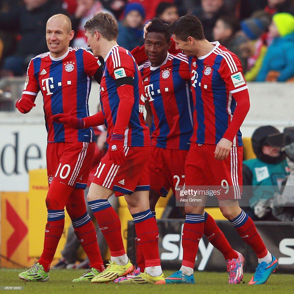 David Alaba of Muenchen celebrates his team's second goal with team mates Arjen Robben Bastian Schweinsteiger and Robert Lewandowski during the...