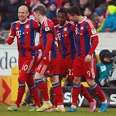 David Alaba of Muenchen celebrates his team's second goal with team mates Arjen Robben Bastian Schweinsteiger and Robert Lewandowski during the...