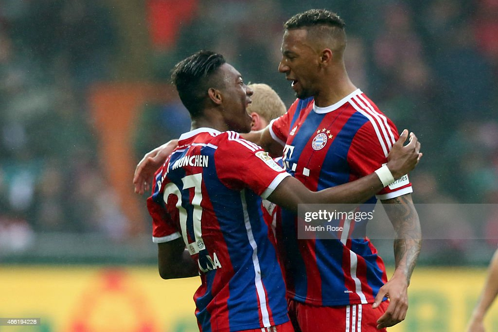 David Alaba of Muenchen celebrates scoring the 2nd goal with his team mate Jerome Boateng during the Bundesliga match between SV Werder Bremen and FC...