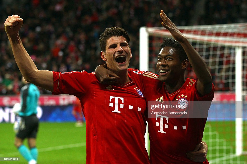 David Alaba of Muenchen celebrates scoring the 2nd team goal with his team mate Mario Gomez during the Bundesliga match between FC Bayern Muenchen...