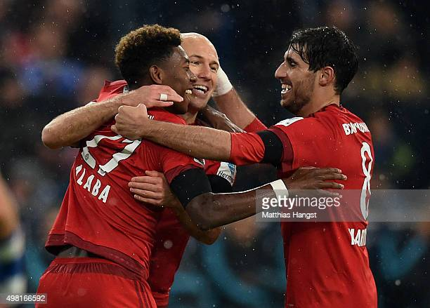 David Alaba of Muenchen celebrates with his teammates after scoring his team's first goal during the Bundesliga match between FC Schalke 04 and FC...