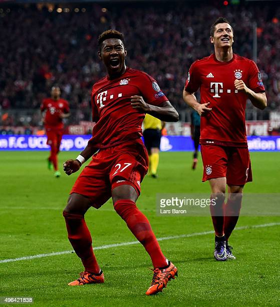 David Alaba of Muenchen celebrates with team mates after scoring his teams third goal during the UEFA Champions League Group F match between FC...
