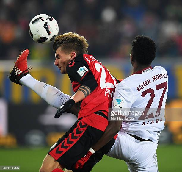 David Alaba of Muenchen challenges Maximilian Philipp of Freiburg during the Bundesliga match between SC Freiburg and Bayern Muenchen at...