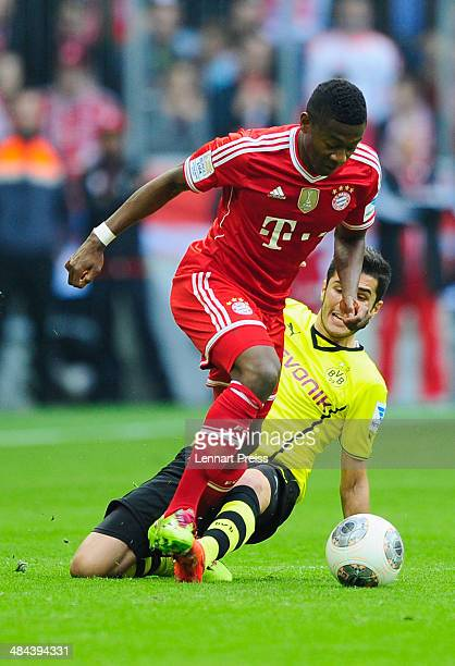 David Alaba of Muenchen challenges Nuri Sahin of Dortmund during the Bundesliga match between FC Bayern Muenchen and Borussia Dortmund at Allianz...