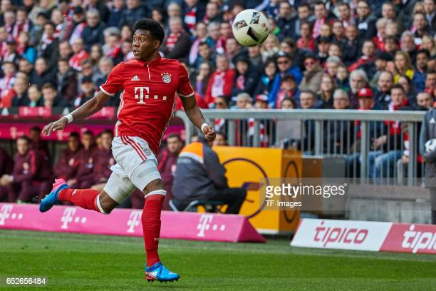 David Alaba of Muenchen controls the ball during the Bundesliga match between Bayern Muenchen and Eintracht Frankfurt at Allianz Arena on March 11...