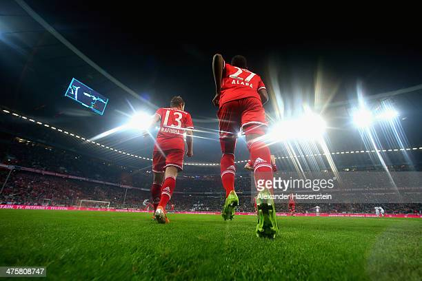 David Alaba of Muenchen enters the field with his team mates for the Bundesliga match between FC Bayern Muenchen and FC Schalke 04 at Allianz Arena...