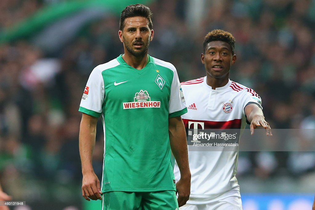 David Alaba of Muenchen looks on with Claudio Pizarro of Bremen during the Bundesliga match between SV Werder Bremen and FC Bayern Muenchen at...