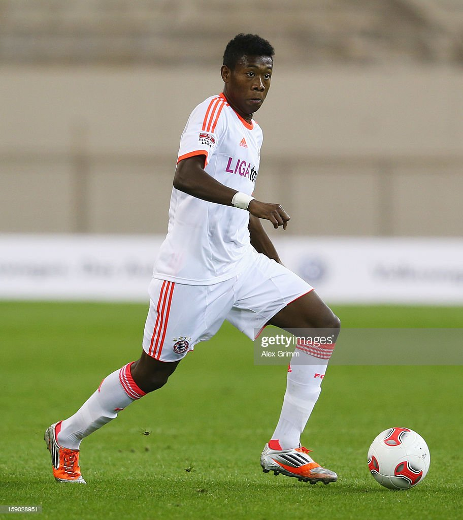 <a gi-track='captionPersonalityLinkClicked' href=/galleries/search?phrase=David+Alaba&family=editorial&specificpeople=5494608 ng-click='$event.stopPropagation()'>David Alaba</a> of Muenchen runs with the ball during the international friendly match between Lekhwiya Sports Club and FC Bayern Muenchen at Khalifa International Stadium on January 5, 2013 in Doha, Qatar.