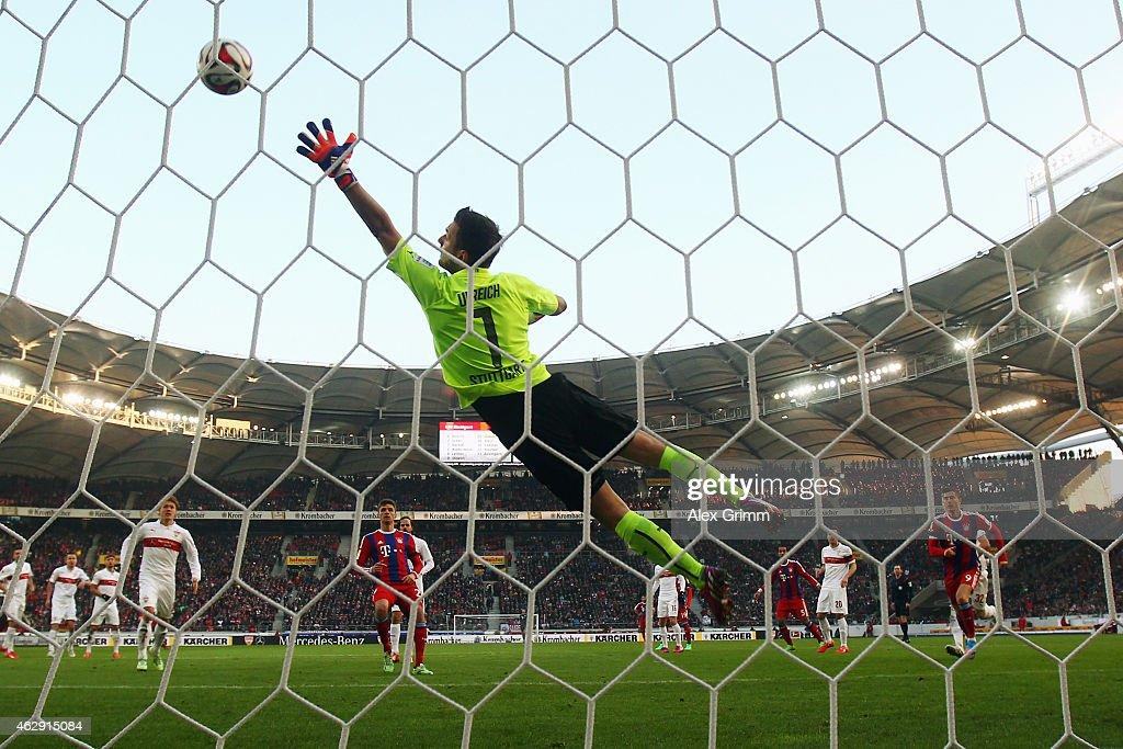 David Alaba of Muenchen scores his team's second goal against goalkeeper Sven Ulreich of Stuttgart during the Bundesliga match between VfB Stuttgart...