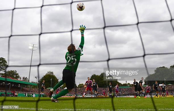 David Alaba of Muenchen scores his teams third goal past goalkeeper Daniel Masuch of Muenster during the DFB Cup first round match between Preussen...