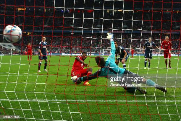 David Alaba of Muenchen scores the 2nd team goal during the Bundesliga match between FC Bayern Muenchen and 1 FC Koeln at Allianz Arena on December...