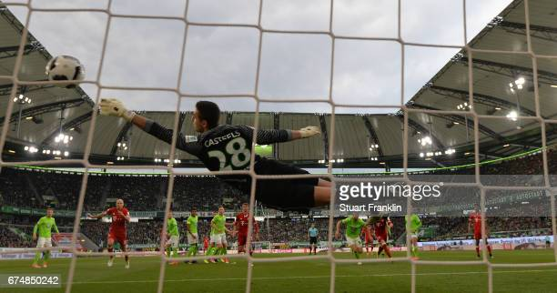 David Alaba of Muenchen scores the first goal during the Bundesliga match between VfL Wolfsburg and Bayern Muenchen at Volkswagen Arena on April 29...