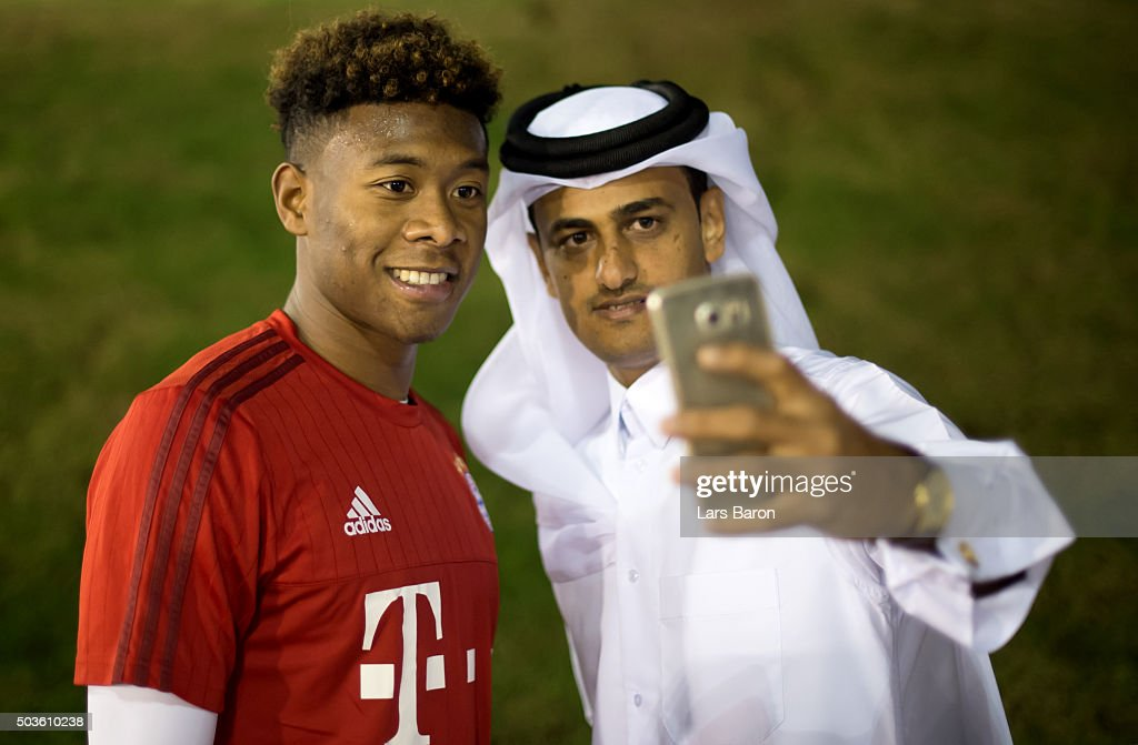 David Alaba poses with a fan after a training session at day one of the Bayern Muenchen training camp at Aspire Academy on January 6 2016 in Doha...