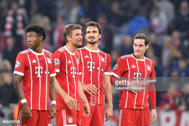 David Alaba Thomas Mueller Mats Hummels and Sebastian Rudy of FC Bayern Muenchen stand together after the UEFA Champions League group B match between...