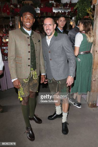 David Alaba wearing a traditional clothes by 'Amsel Fashion' and Franck Ribery during the 'FC Bayern Wies'n' as part of the Oktoberfest at...