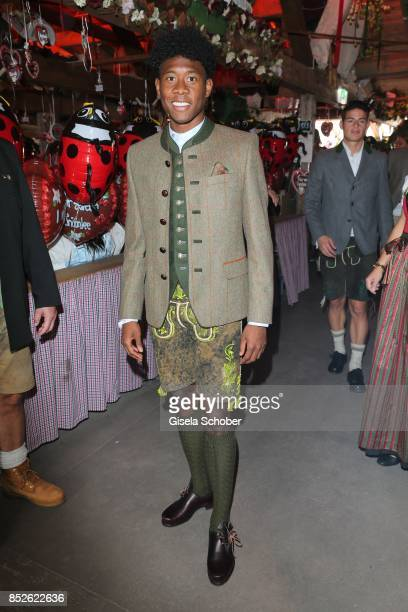 David Alaba wearing a traditional clothes by 'Amsel Fashion' during the 'FC Bayern Wies'n' as part of the Oktoberfest at Theresienwiese on September...