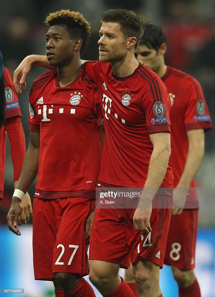 David Alaba, Xabi Alonso and Javi Martinez (L-R) of Bayern Muenchen react after their team's loss of the Champions League semi final second leg match between FC Bayern Muenchen and Club Atletico de Madrid at Allianz Arena on May 3, 2016 in Munich, Germany.