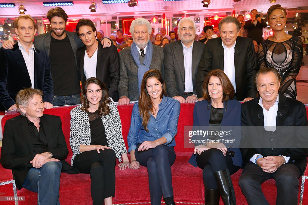 David Alexis, Tom Leeb, Kevin Levy, Michel Loeb, Guy Savoy, Michel Drucker, Lisa Simone, (Front L-R) Roman Polanski, Elsa Leeb, Fanny Leeb, Beatrice Leeb and her husband, main guest of the show Michel Leeb attend the 'Vivement Dimanche' French TV Show at Pavillon Gabriel on January 7, 2015 in Paris, France.