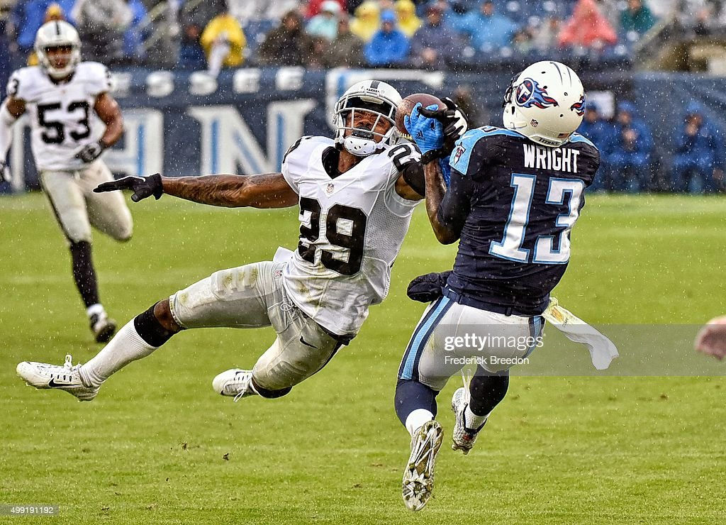 <a gi-track='captionPersonalityLinkClicked' href=/galleries/search?phrase=David+Amerson&family=editorial&specificpeople=7244765 ng-click='$event.stopPropagation()'>David Amerson</a> #29 of the Oakland Raiders defends the ball away from <a gi-track='captionPersonalityLinkClicked' href=/galleries/search?phrase=Kendall+Wright&family=editorial&specificpeople=5556154 ng-click='$event.stopPropagation()'>Kendall Wright</a> #13 of the Tennessee Titans during the second half at Nissan Stadium on November 29, 2015 in Nashville, Tennessee.