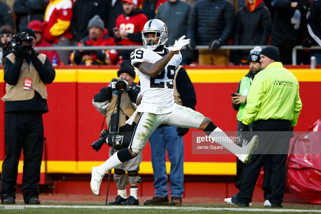 <a gi-track='captionPersonalityLinkClicked' href=/galleries/search?phrase=David+Amerson&family=editorial&specificpeople=7244765 ng-click='$event.stopPropagation()'>David Amerson</a> #29 of the Oakland Raiders scores a touchdown after an interception at Arrowhead Stadium during the second quarter of the game against the Oakland Raiders on January 3, 2016 in Kansas City, Missouri.