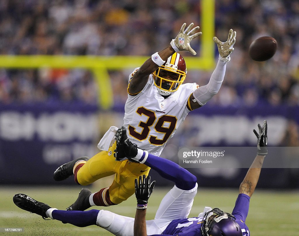 <a gi-track='captionPersonalityLinkClicked' href=/galleries/search?phrase=David+Amerson&family=editorial&specificpeople=7244765 ng-click='$event.stopPropagation()'>David Amerson</a> #39 of the Washington Redskins breaks up a pass intended for <a gi-track='captionPersonalityLinkClicked' href=/galleries/search?phrase=Jerome+Simpson&family=editorial&specificpeople=5085139 ng-click='$event.stopPropagation()'>Jerome Simpson</a> #81 of the Minnesota Vikings during the second quarter of the game on November 7, 2013 at Mall of America Field at the Hubert H. Humphrey Metrodome in Minneapolis, Minnesota.