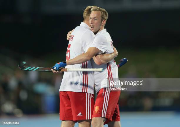 David Ames of England and Barry Middleton of England celebrate after the quarter final match between England and Canada on day seven of the Hero...