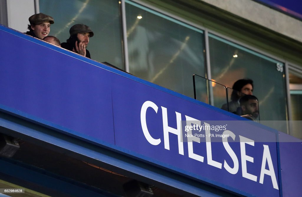 David and Brooklyn Beckham watch the game during the Emirates FA Cup, Quarter Final match at Stamford Bridge, London.