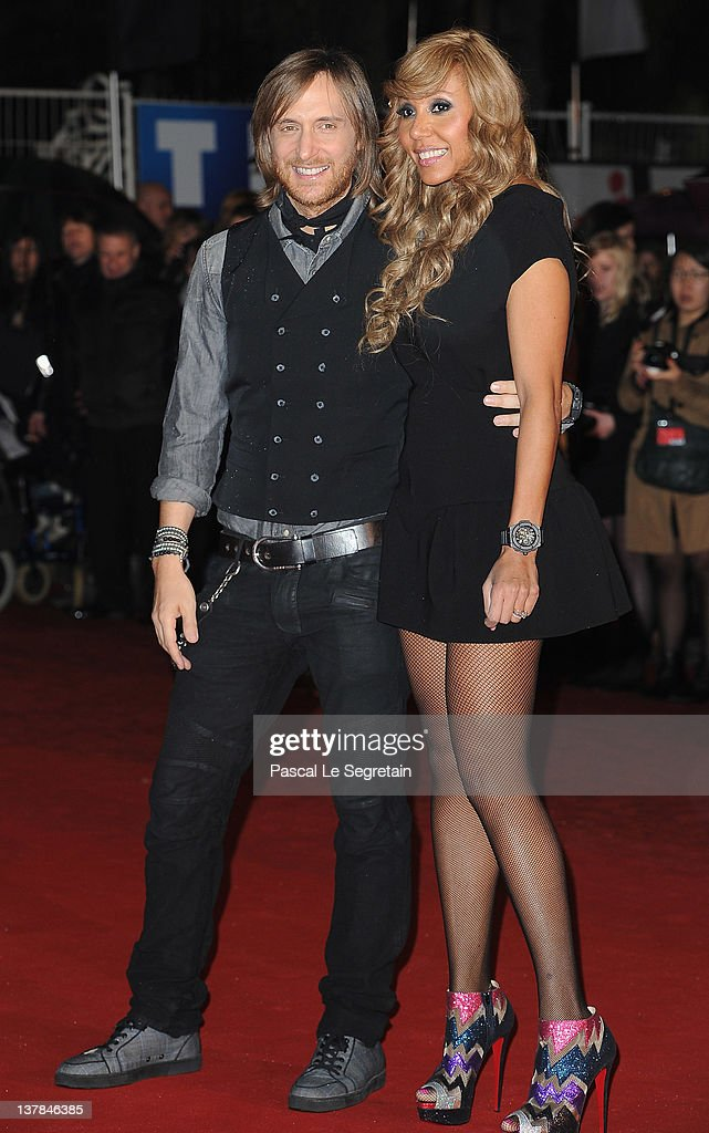 David and Cathy Guetta pose as they arrive at NRJ Music Awards 2012 at Palais des Festivals on January 28 2012 in Cannes France