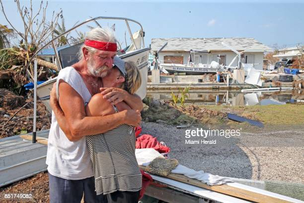 David and Dee Thorne hug near the remains of their home following Hurricane Irma on Big Pine Key in the Florida Keys on September 20 2017 They are...