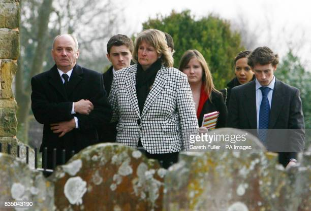 David and Nicola Gauntlett accompanied by family members arrive for the funeral Rob Gauntlett at St Mary's Church in Billingshurst West Sussex after...