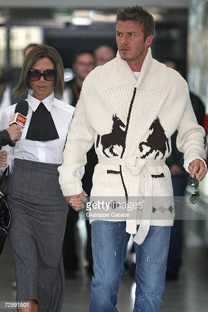 David and Victoria Beckham arrive at Ciampino Airport for Katie Holmes and Tom Cruise wedding at Bracciano on November 17 2006 in Rome Italy