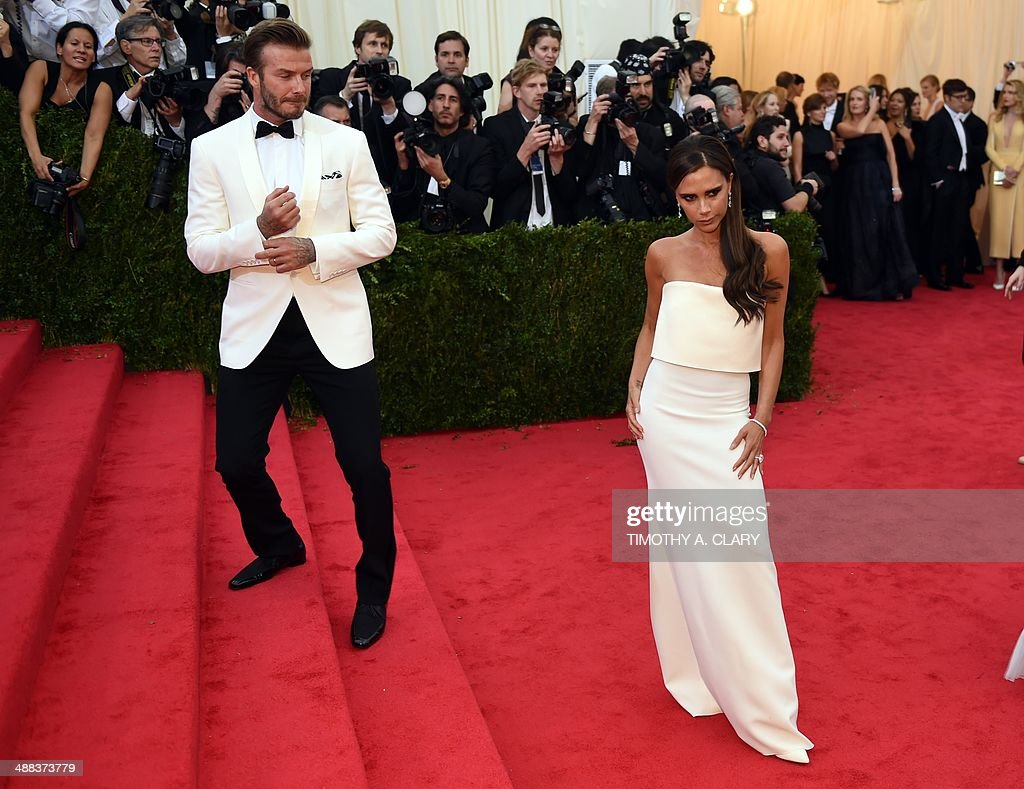 David and <a gi-track='captionPersonalityLinkClicked' href=/galleries/search?phrase=Victoria+Beckham&family=editorial&specificpeople=161100 ng-click='$event.stopPropagation()'>Victoria Beckham</a> arrive at the Costume Institute Benefit at The Metropolitan Museum of Art May 5, 2014 in New York. AFP PHOTO/Timothy A. CLARY