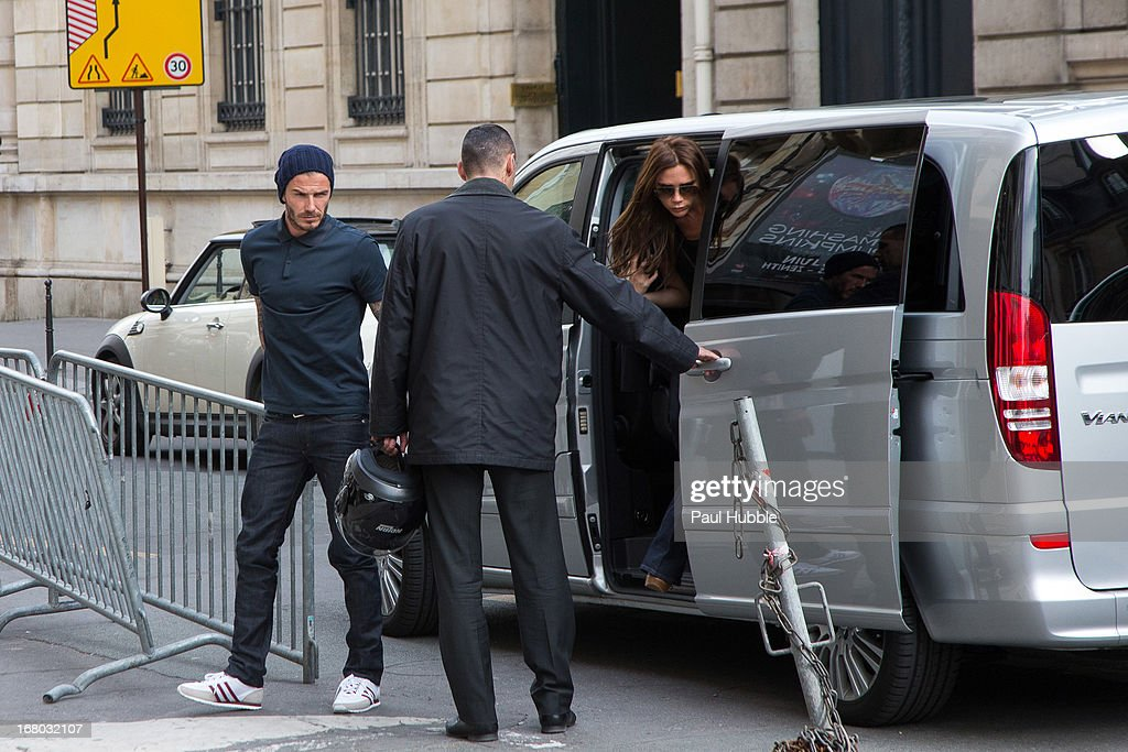 David and <a gi-track='captionPersonalityLinkClicked' href=/galleries/search?phrase=Victoria+Beckham&family=editorial&specificpeople=161100 ng-click='$event.stopPropagation()'>Victoria Beckham</a> is seen arriving at the 'Comme des garcons' store on May 4, 2013 in Paris, France.