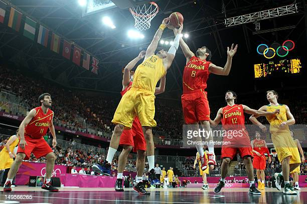 David Andersen of Australia competes for a rebound in the Men's Basketball Preliminary Round match between Australia and Spain on Day 4 of the London...