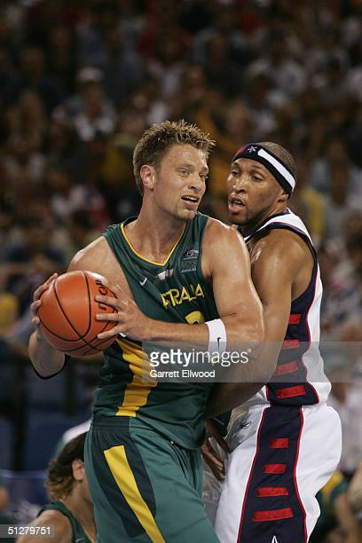 David Andersen of Australia drives around Shawn Marion of the USA during the Athens 2004 Summer Olympic Games at the Indoor Hall of the Olympic...