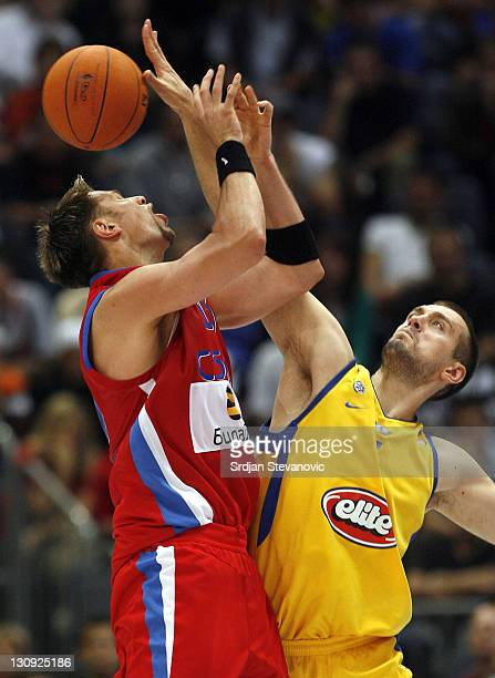 David Andersen of CSKA Moscow is blocked by Nikola Vujcic of Maccabi Tel Aviv during a NBA Live Tour friendly basketball match between CSKA Moscow...