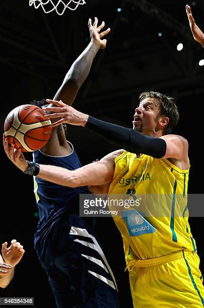 David Andersen of the Boomers charges to the basket during the match between the Australian Boomers and the Pac12 College AllStars at Hisense Arena...
