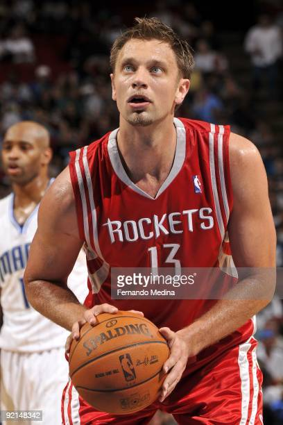 David Andersen of the Houston Rockets shoots a free throw during the preseason game against the Orlando Magic on October 9 2009 at Amway Arena in...