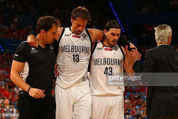 David Anderson of United is assisted from the court with an injury during the round 10 NBL match between the Perth Wildcats and Melbourne United at...