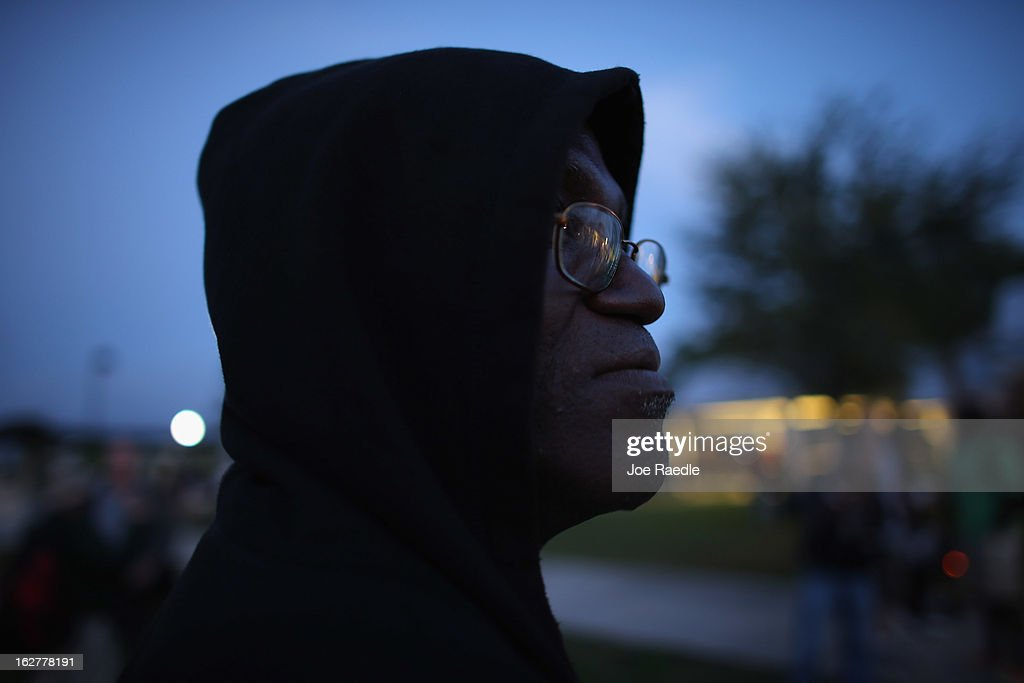 David Anderson wears a hoodie as he attends a vigil at Fort Mellon Park to mark the one year anniversary of when Trayvon Martin was killed on February 26, 2013 in Sanford, Florida. Martin was shot by George Zimmerman on February 26, 2012 while Zimmerman was on neighborhood watch patrol in the gated community of The Retreat at Twin Lakes in Sanford, Florida.