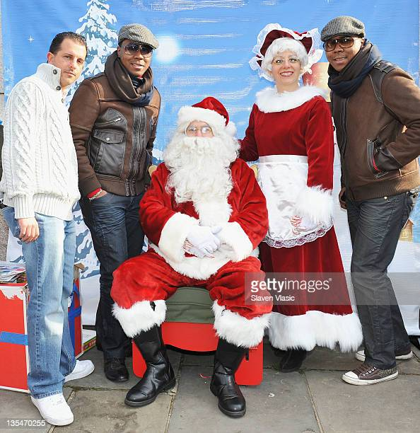 David Annarummo Antoine Von Boozier and Andre Von Boozier attend the Help Santa Stuff a Buss Full of Toys event at the Cannon Ball Park on December...